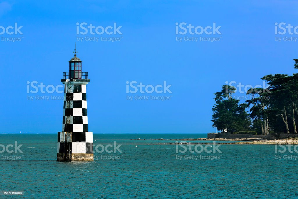 Lighthouse outside Loctudy, as Seen from Ile-Tudy, Brittany stock photo