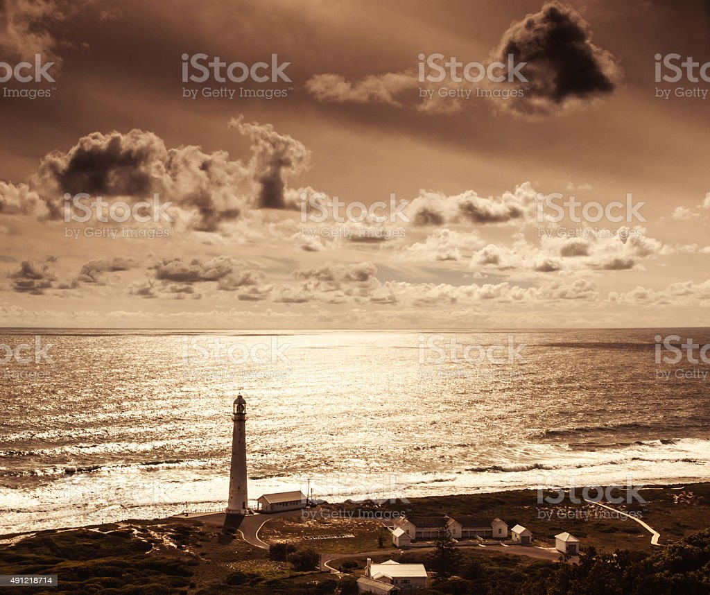 Lighthouse over sunset stock photo