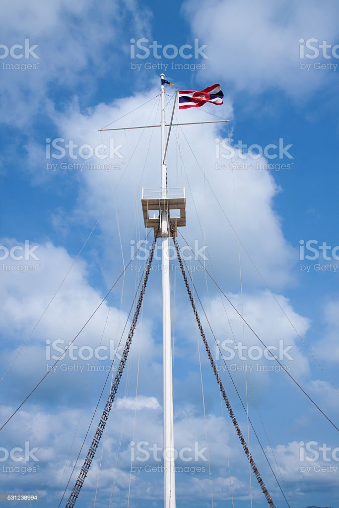 Lighthouse pole with thai flag on sky background royalty-free stock photo