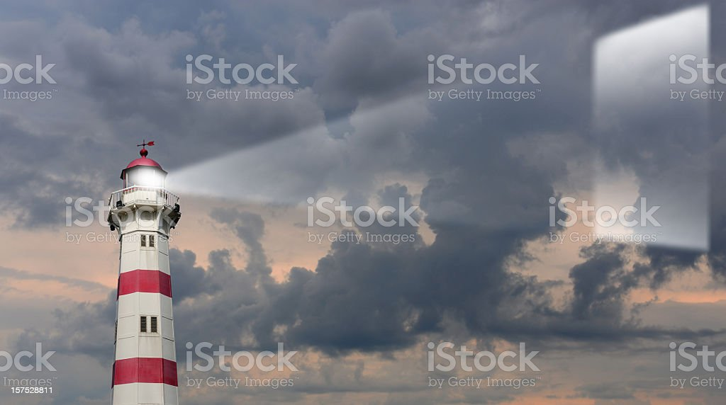 Lighthouse projects message on sky royalty-free stock photo
