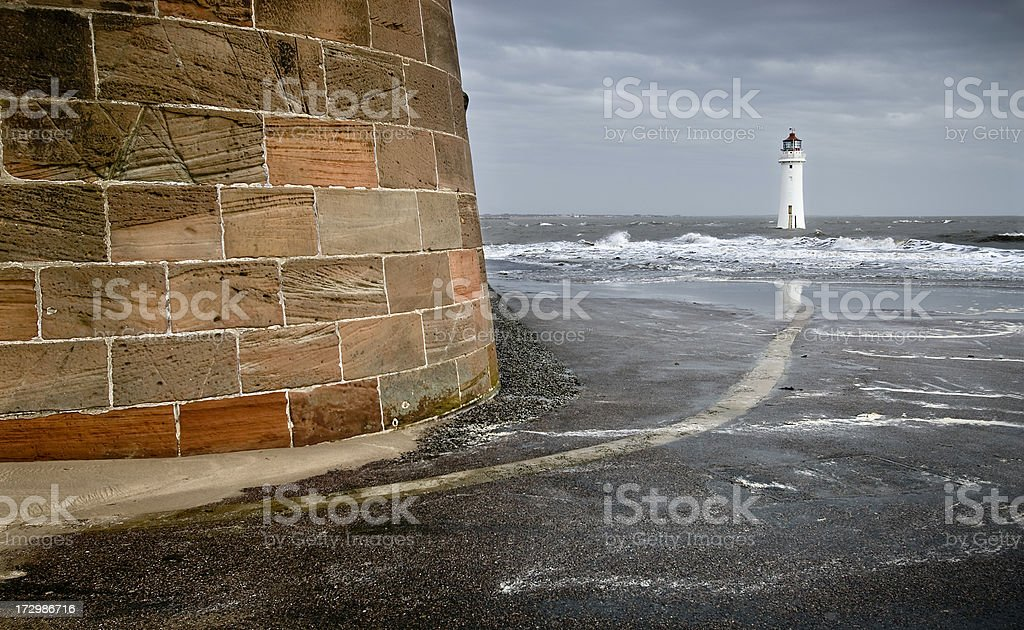 Lighthouse, sea and fortress royalty-free stock photo