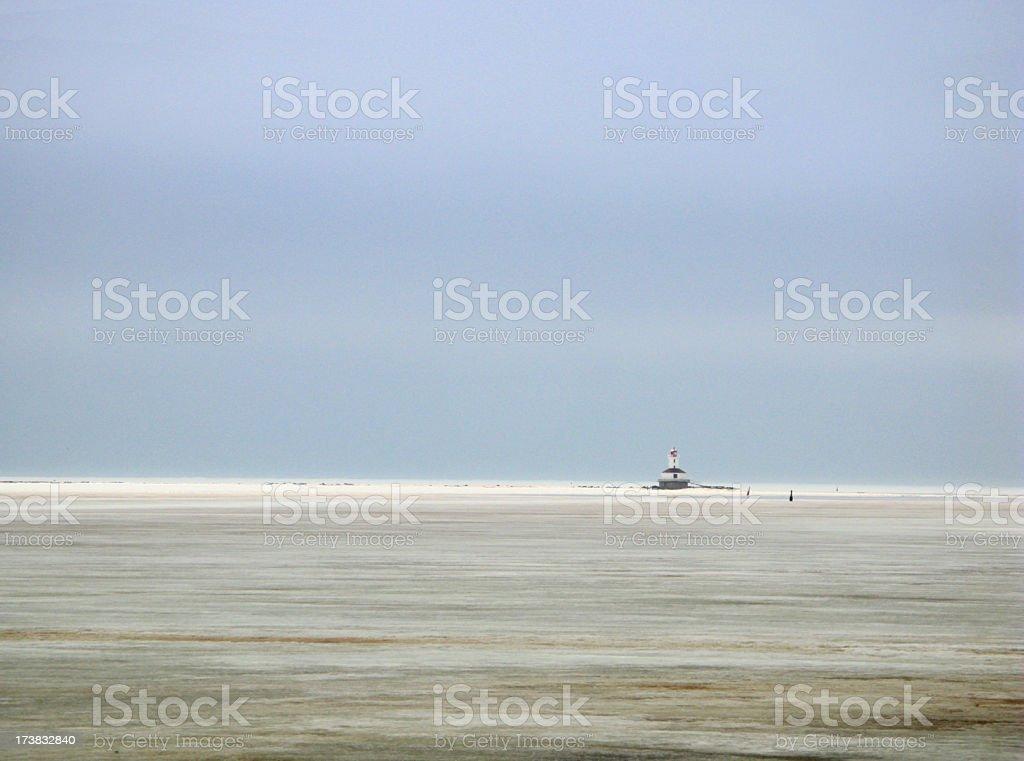 Lighthouse, Sea Ice and Sky. stock photo