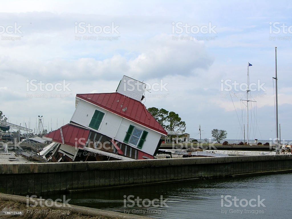 Lighthouse sinking in the water stock photo