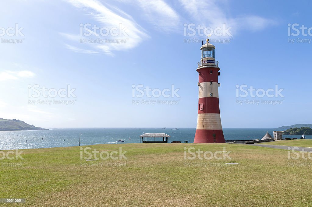 Lighthouse surrounded by grass in Plymouth stock photo