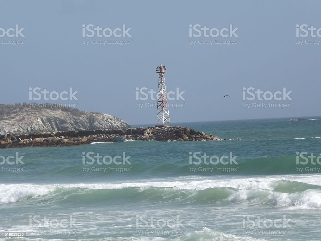 Lighthouse tower in El Tirano Beach stock photo