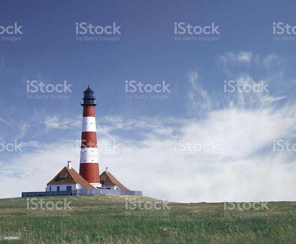 Lighthouse under blue sky royalty-free stock photo