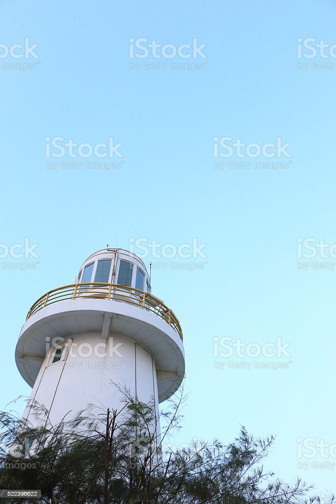 lighthouse under the emtry sky stock photo