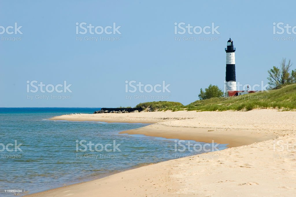 Lighthouse with Beach Coastline, Michigan Shore Great Lakes stock photo