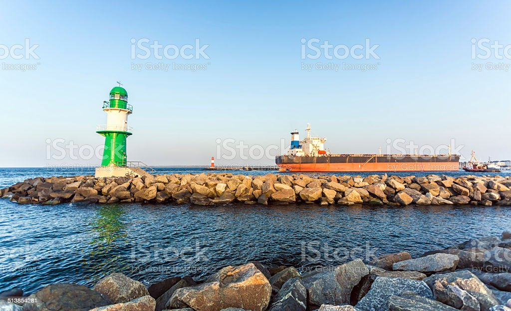 Lighthouse with big ship in Warnem?nde stock photo