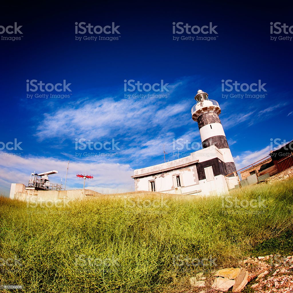 Lighthouse with blue sky stock photo