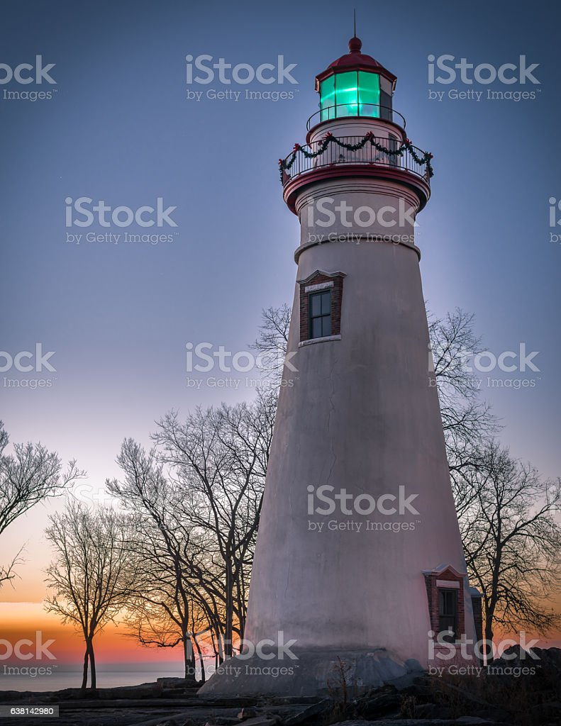 lighthouse with Christmas lights stock photo