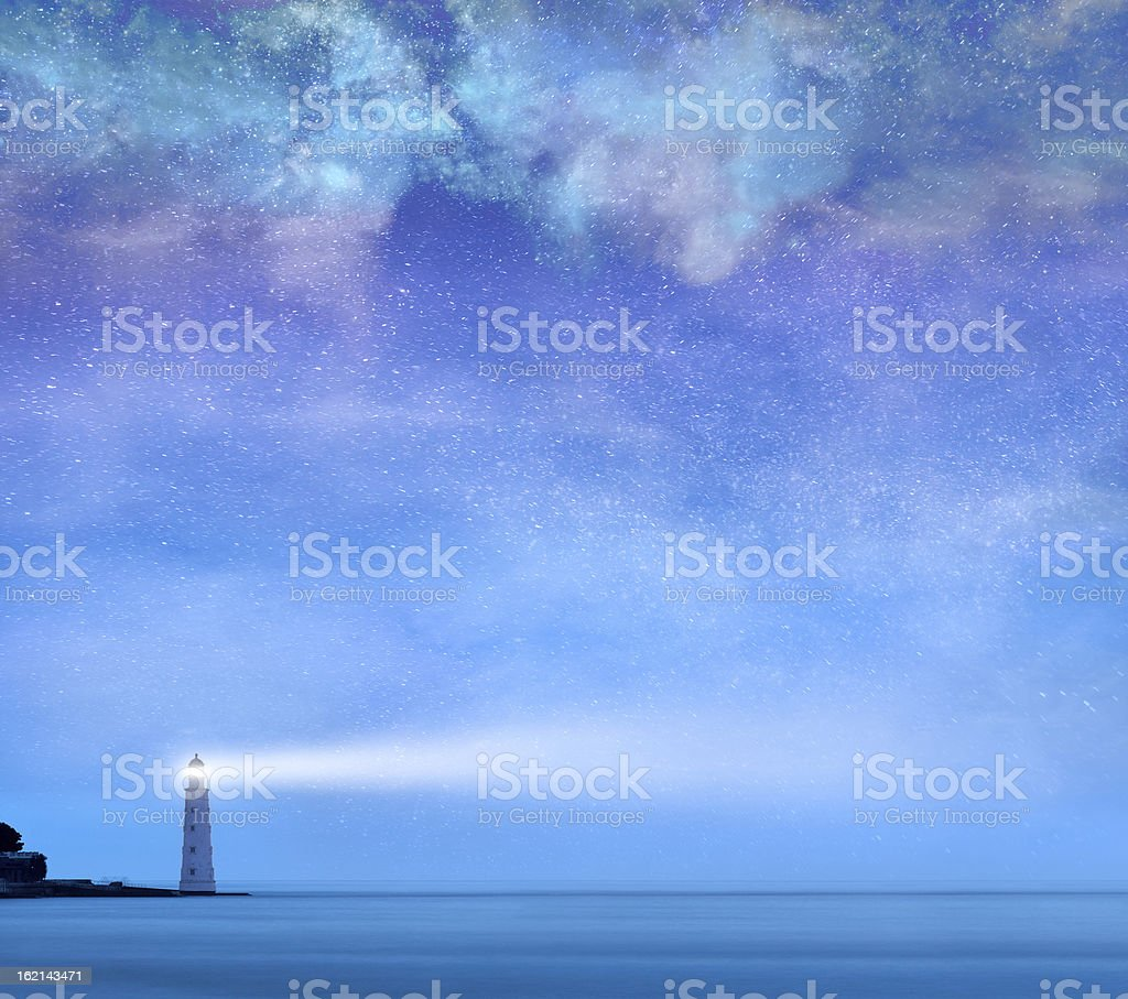 Lighthouse with stars at night stock photo