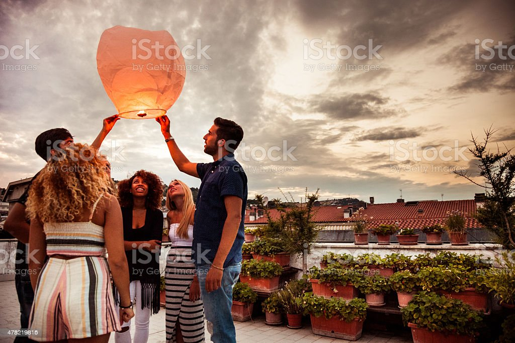 Lighting a chinese lantern at birthday party stock photo