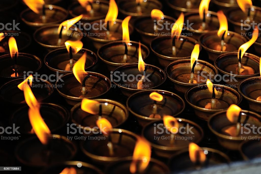 lighting a lamp for peace stock photo