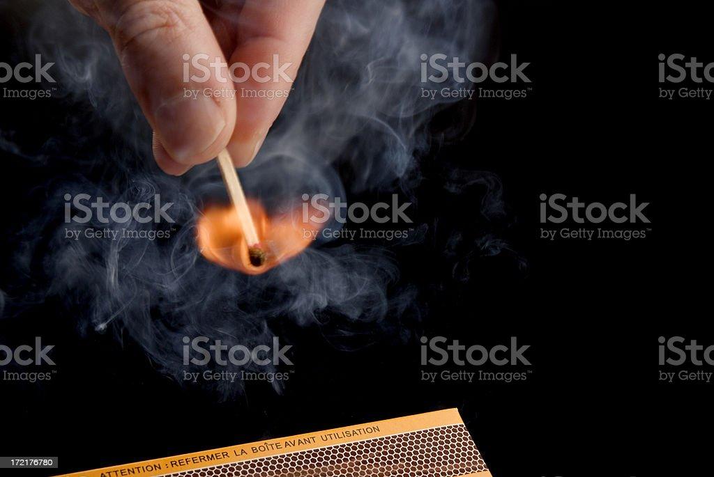 Lighting a Match stock photo