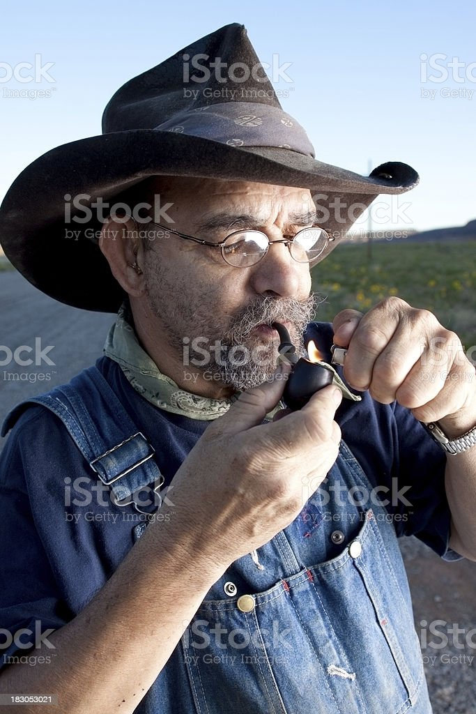 Lighting a pipe stock photo