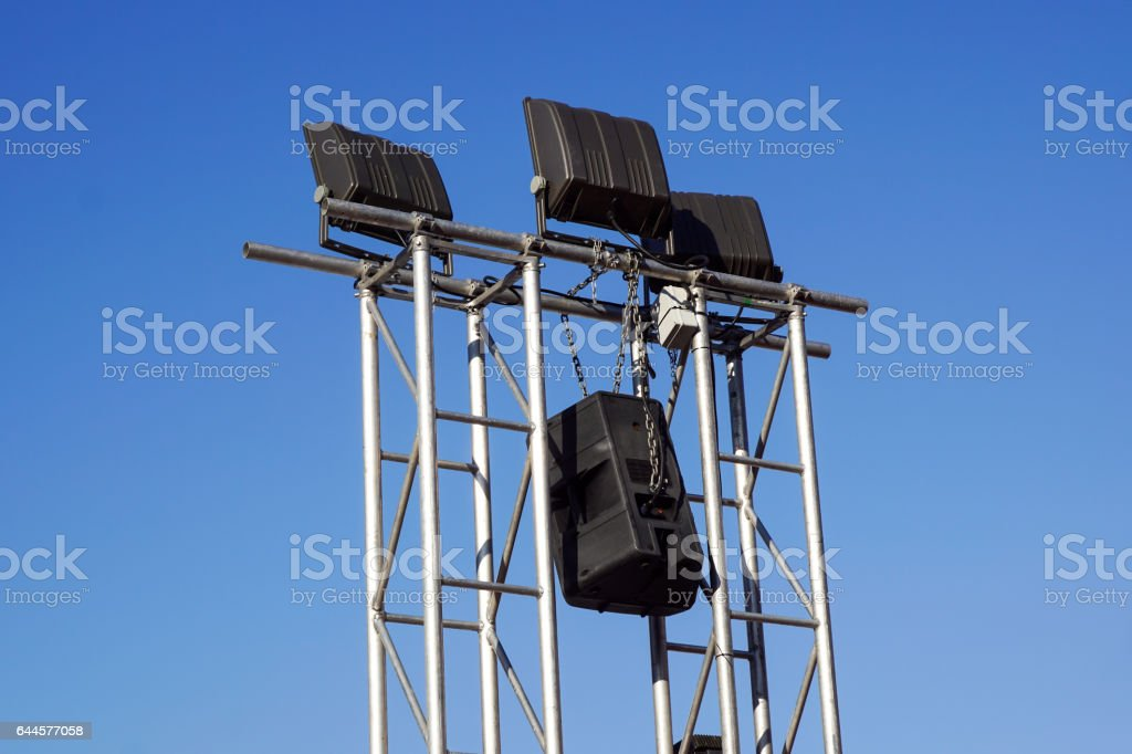 lighting and sound equipment on a stage of a concert stock photo