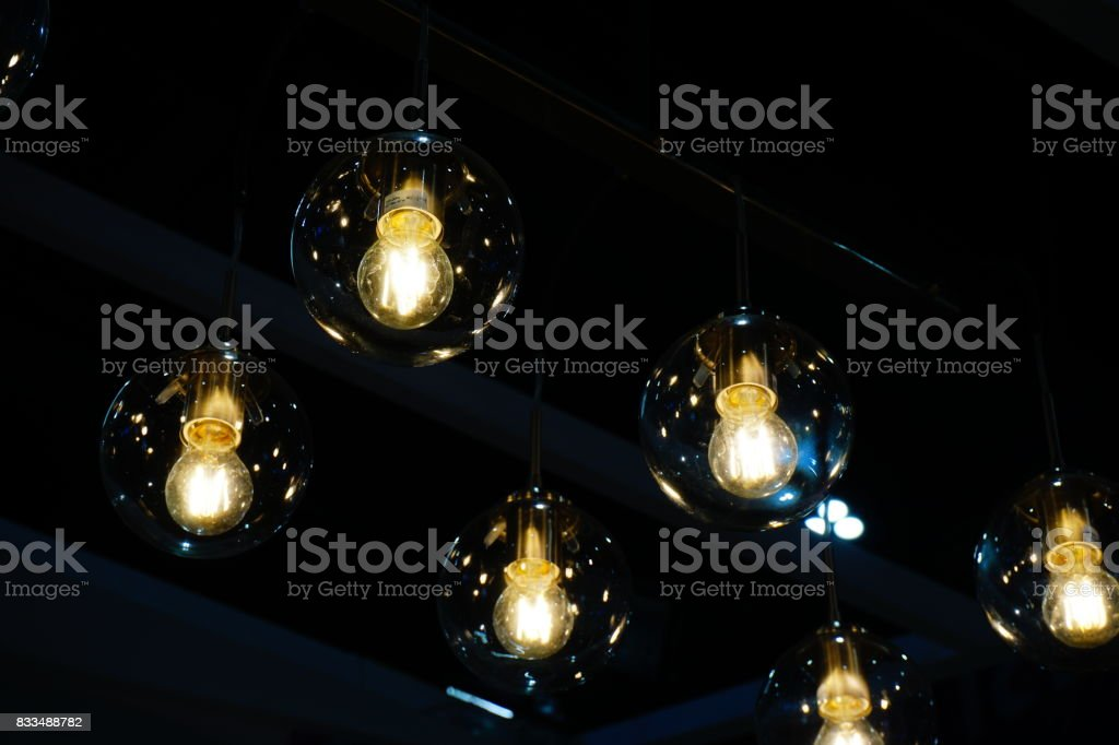 Lighting ball hanging from the ceiling stock photo