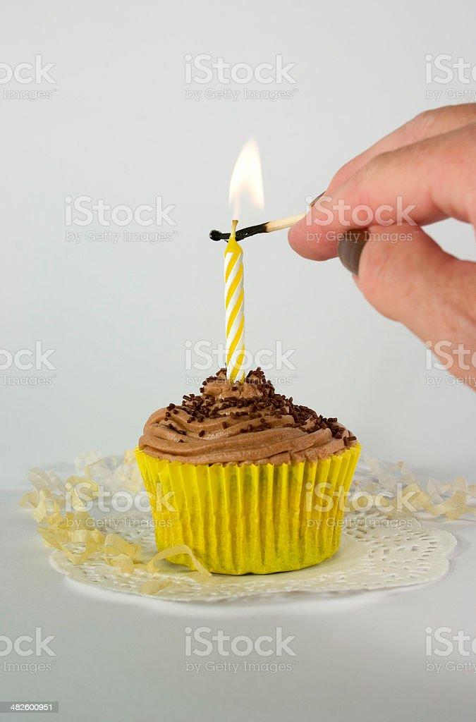 Lighting Birthday Candle on Chocolate Cupcake stock photo
