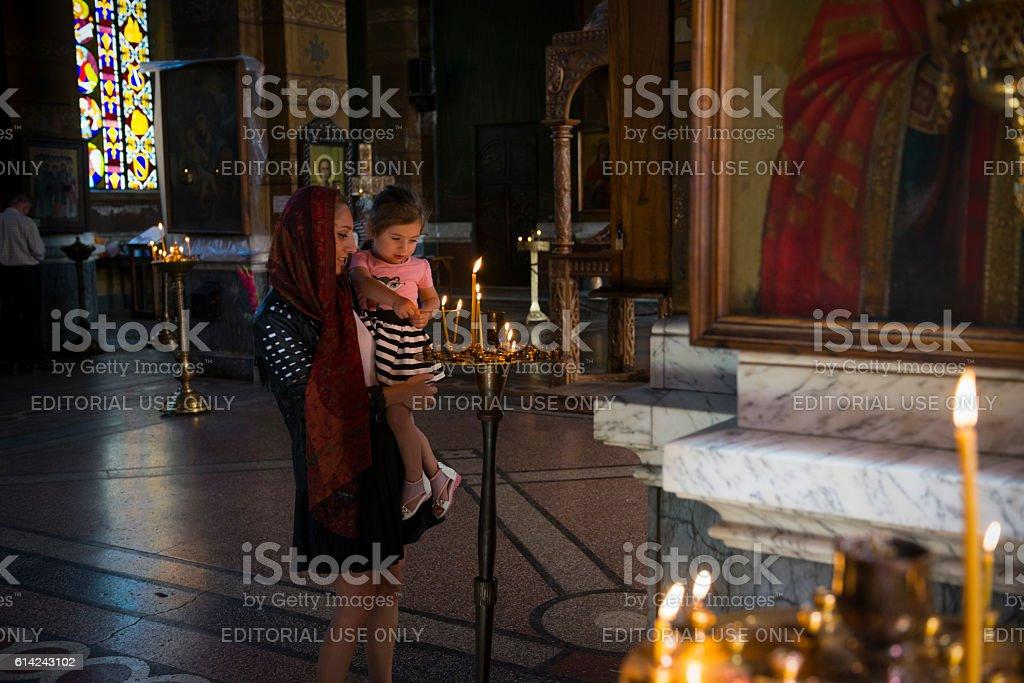 Lighting candles at Georgian Orthodox church in Batumi stock photo