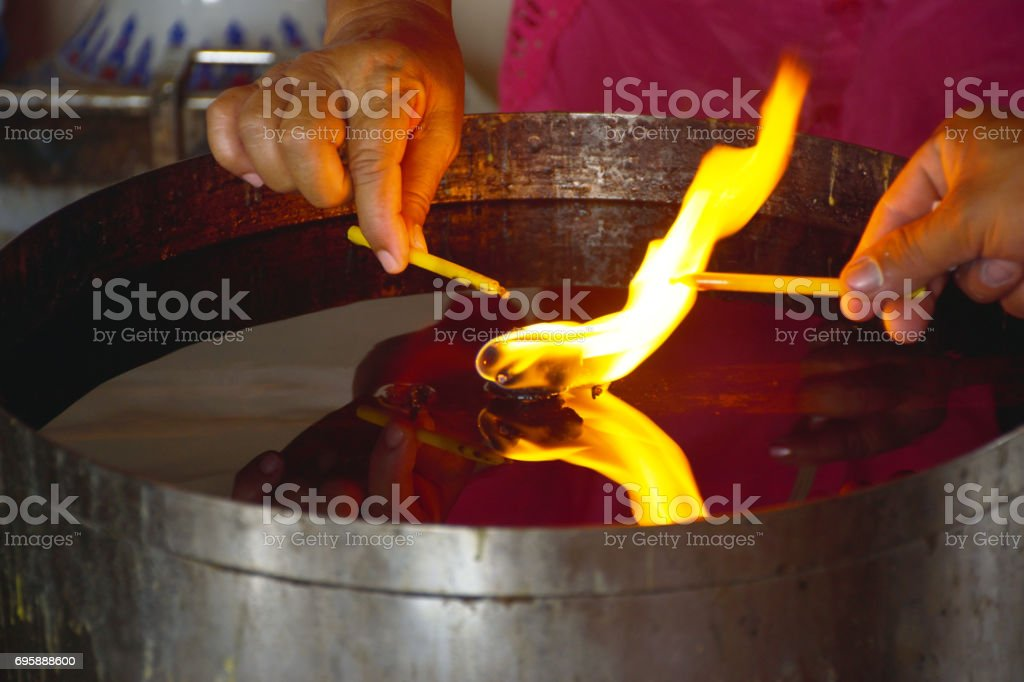 Lighting candles in the buddhist temple stock photo