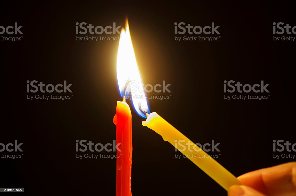 Lighting candles stock photo