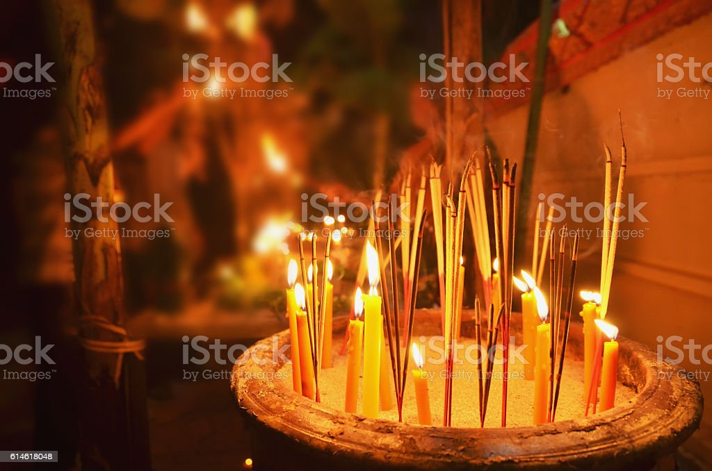 lighting candles to worship the Buddha on the end stock photo