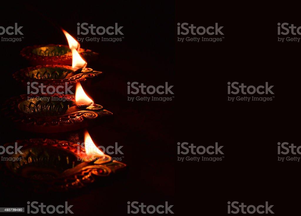 lighting diya- Diwali Celebrations stock photo