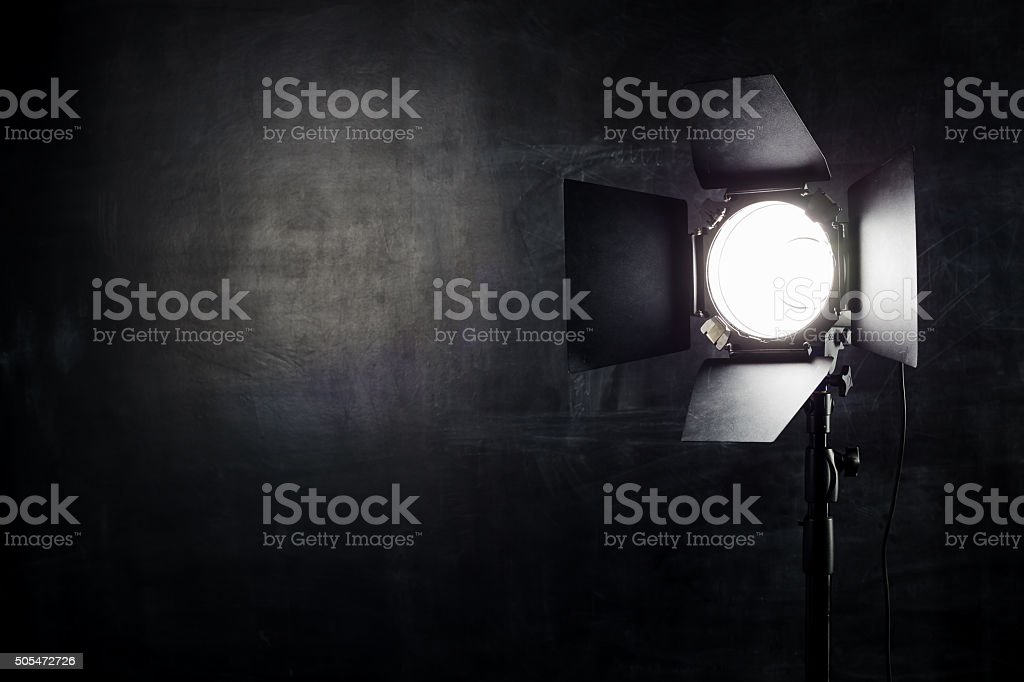 Lighting equipment on a black background old shabby wall stock photo
