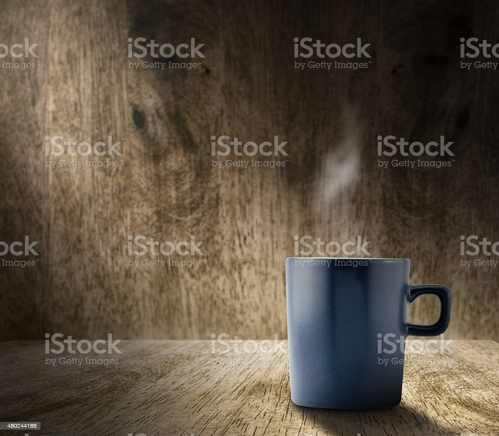 Lighting from window with blue coffee cup in wood room stock photo