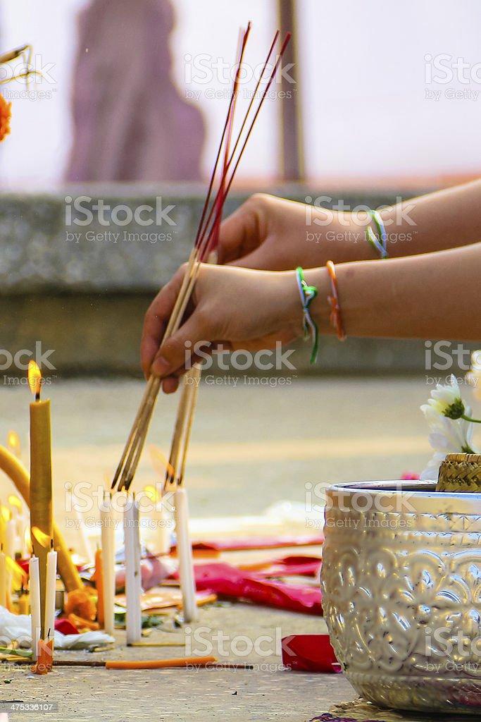Lighting Joss sticks in Laos stock photo