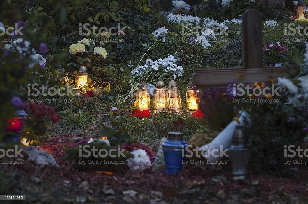 Lighting lampions and flowers in a cemetery stock photo