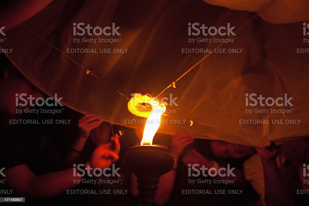 Lighting Lantern at Loi Krathong Festival stock photo