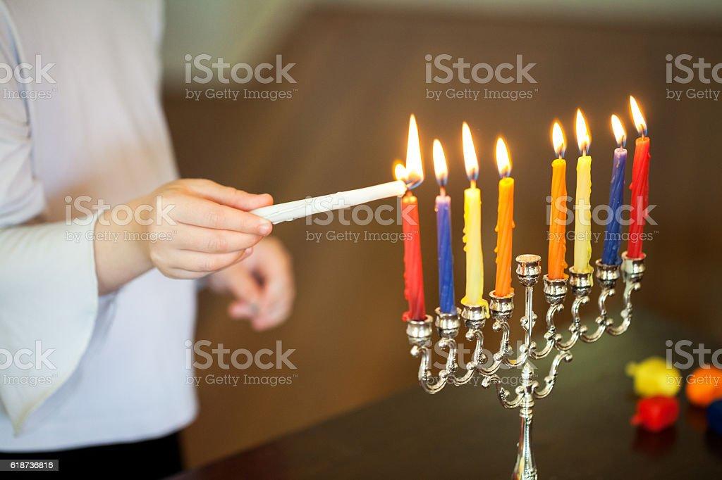 Lighting menorah stock photo