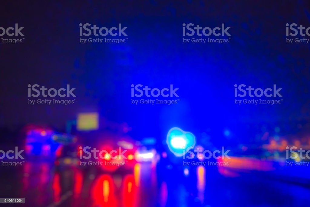 lighting of police car in the night during accident -blurred. stock photo