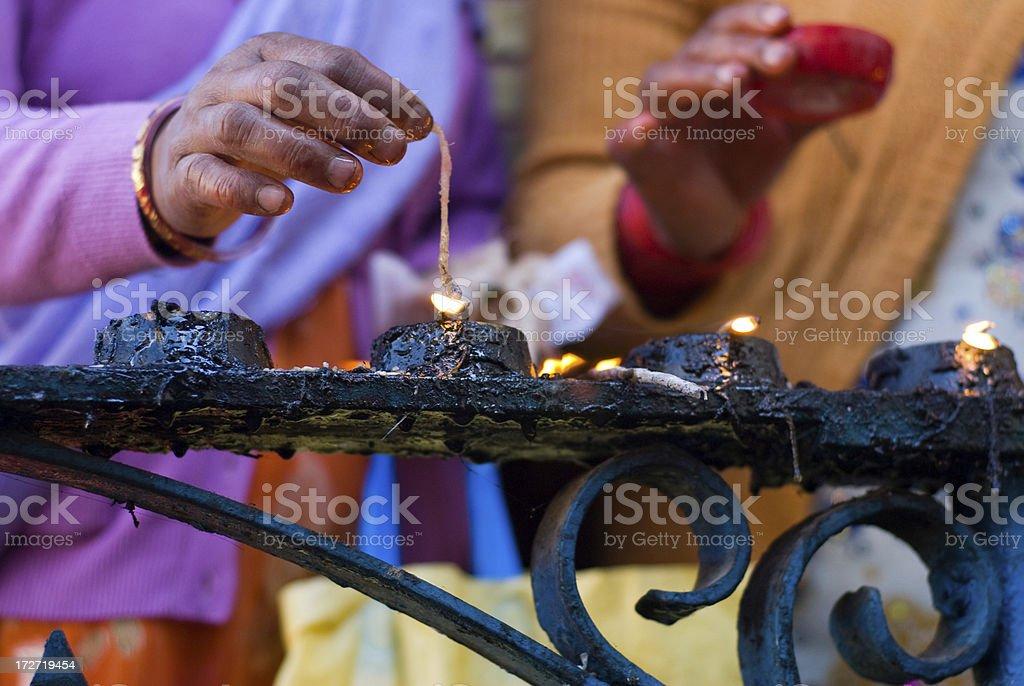 lighting ritual stock photo