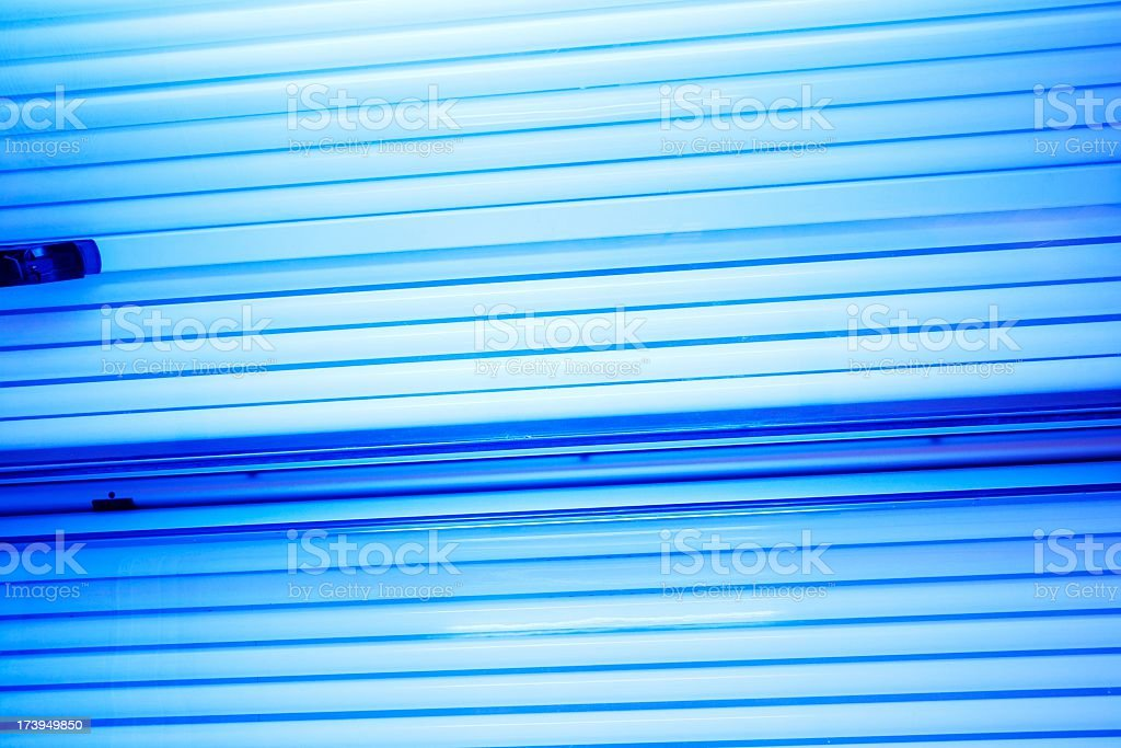 Lighting Tanning bed tubes background stock photo