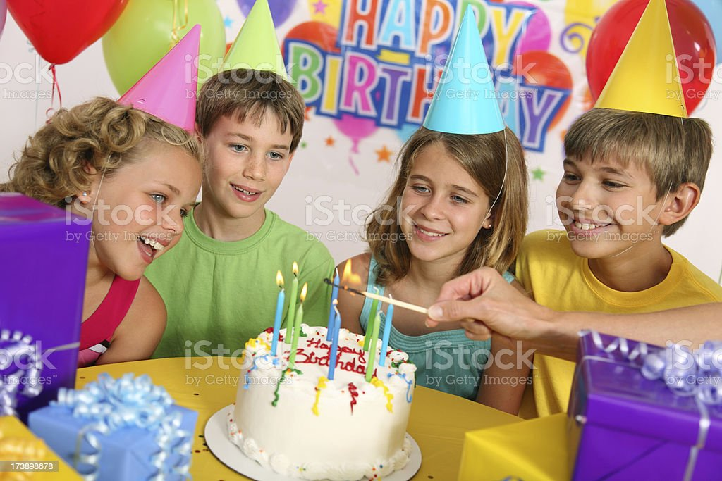 Lighting The Birthday Candles royalty-free stock photo