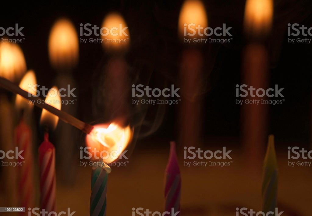 Lighting the candle stock photo