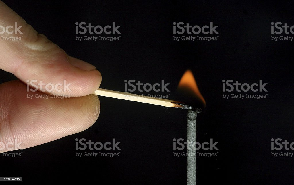 lighting the fuse royalty-free stock photo