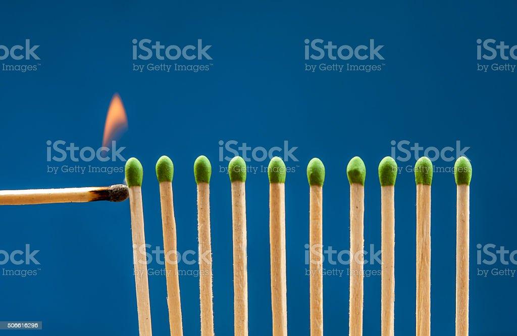 Lighting the matches. stock photo