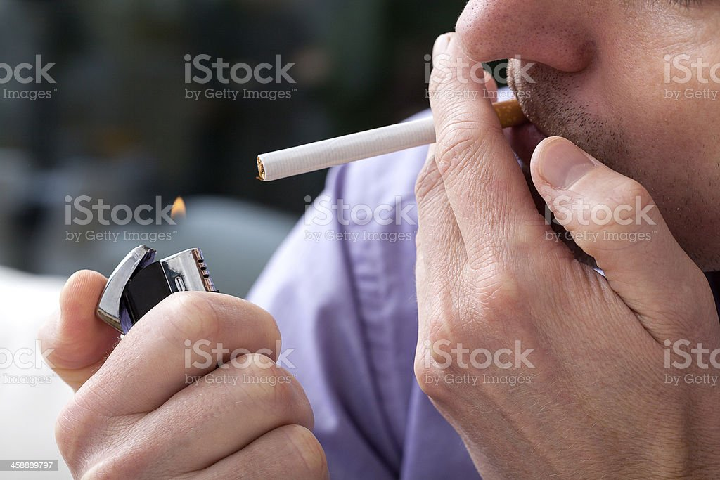Lighting up a cigarette stock photo