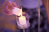 lighting white candle (soft focus)