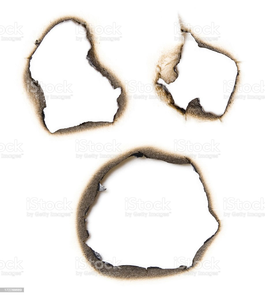 Lightly burnt paper holes royalty-free stock photo