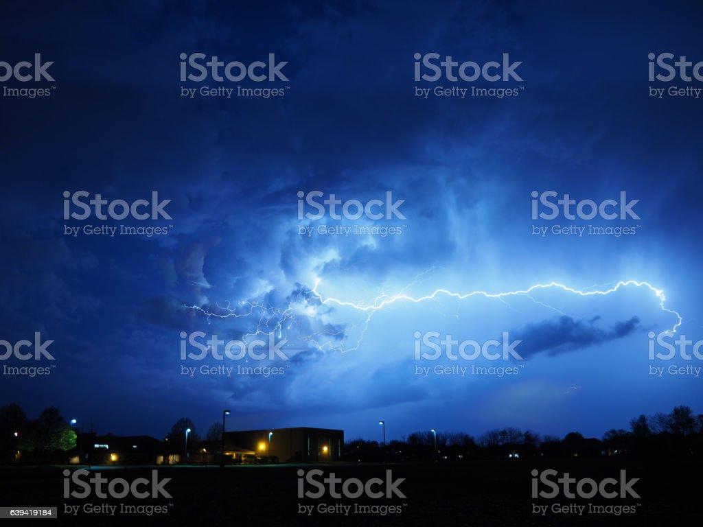 Lightning across the sky stock photo