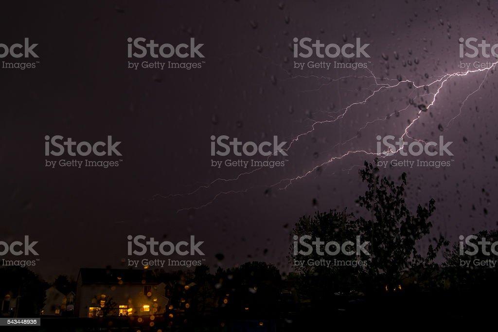 Lightning at night through window stock photo