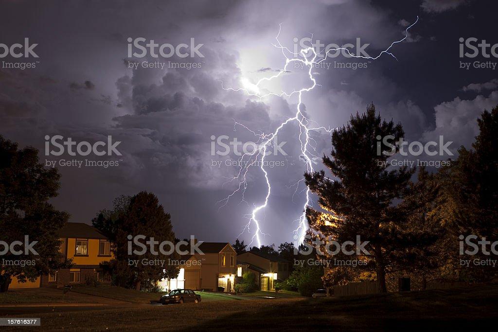 Lightning bolt and thunderhead storms over Denver neighborhood homes royalty-free stock photo