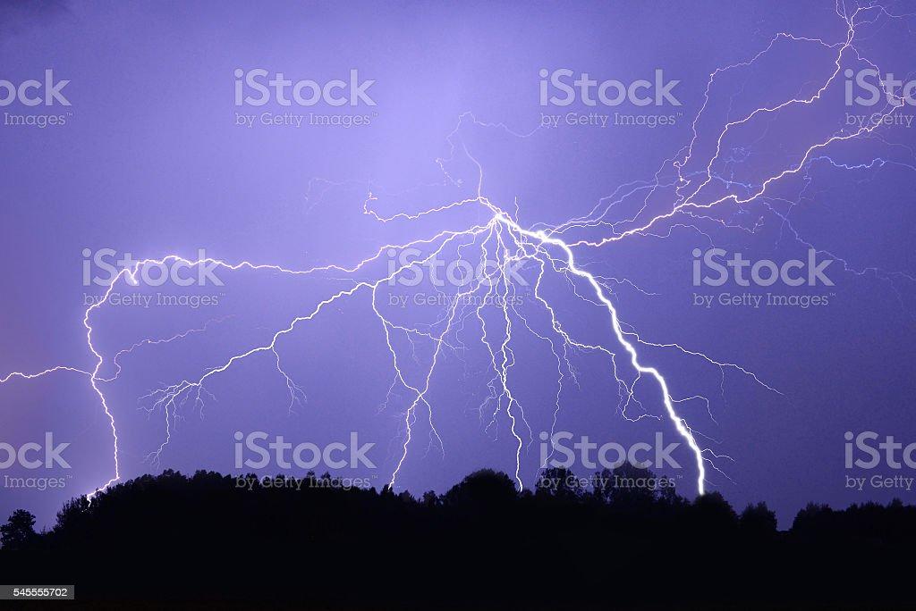 Lightning bolt at night stock photo