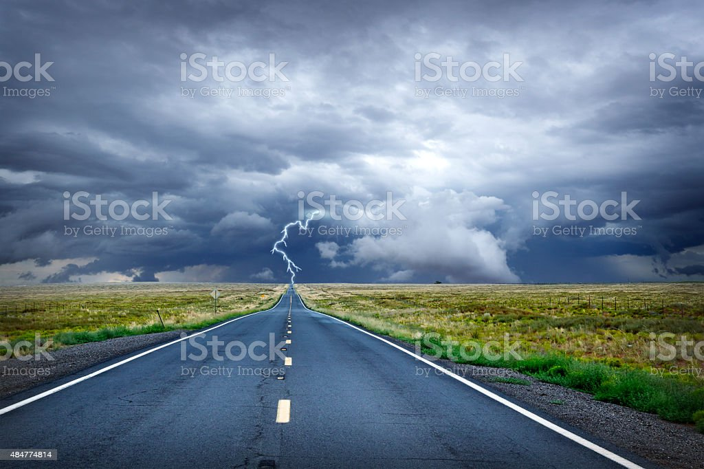 Lightning Bolt At The End Of Long Rural Road stock photo
