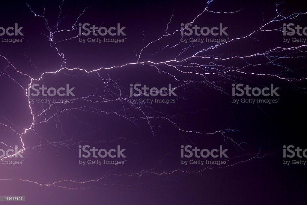 Lightning Flashes Across the Night Sky royalty-free stock photo